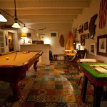 Game Room Image with Betsy Ross flag, pool table, white painted walls, nice looking furnitures and decors at night highlighting floor arts and designs