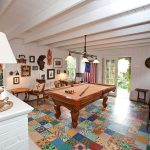 Game Room Image with pool table, white painted walls, nice looking furnitures and decors